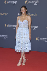 Paula Patton chose a pair of nude ankle-tie peep-toe heels to finish off her look.