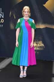 Electric-blue satin sandals rounded out Cara Theobold's exuberant look.