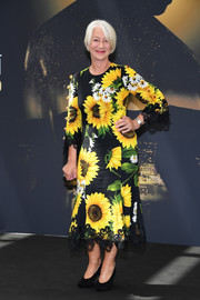 Helen Mirren looked upbeat in a Dolce & Gabbana midi dress featuring an oversized sunflower print on day 5 of the Monte Carlo TV Festival.
