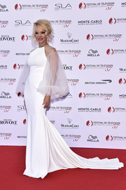 Pamela Anderson oozed glamour wearing this white Gauri & Nainika fishtail gown with sheer, voluminous sleeves at the Monte Carlo TV Festival opening ceremony.