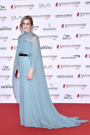 Cara Theobold looked ethereal in a caped blue gown by Alberta Ferretti at the Monte Carlo TV Festival opening ceremony.