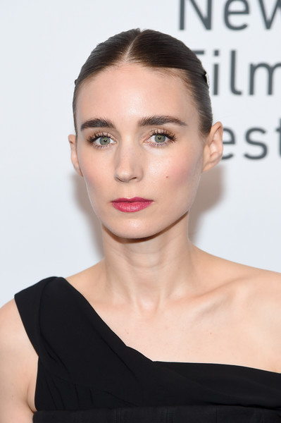 Rooney Mara's pink lipstick added a welcome pop of color to her black look.