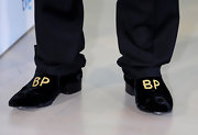 On anyone but Brad Pitt, monogrammed footwear might appear egomaniacal. How do you like Brad's BP slippers?