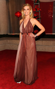 Faith always brings her own unique style to the red carpet. Here she wears an interesting halter dress by J. Mendel.