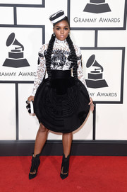 Janelle Monae wore a high-neck black-and-white lace top by Jean Paul Gaultier to the Grammys.