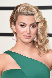 Tori Kelly wore her signature curly hair swept to the side when she attended the Grammys.