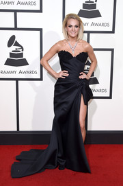 Carrie Underwood went for full-on glamour at the Grammys in a strapless black Nicolas Jebran gown with a sweetheart neckline and a thigh-flaunting slit.