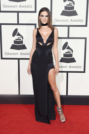 Alessandra Ambrosio attended the Grammys looking super sexy (as always) in a black cutout gown by Versace.
