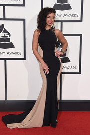 Mya cut a shapely silhouette in this body-con black and beige gown during the Grammys.