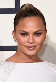 Chrissy Teigen paired her ponytail with huge diamond studs by Lorraine Schwartz.