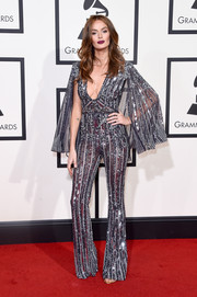 Nicole Trunfio dazzled in a '70s-inspired caped and sequined jumpsuit by Zuhair Murad Couture at the Grammys.