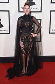 Skylar Grey caught eyes in a caped, face-embroidered sheer gown at the Grammys.
