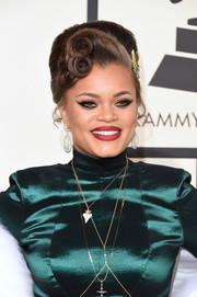 Andra Day looked retro-glam wearing this teased updo with sculpted curls at the Grammys.
