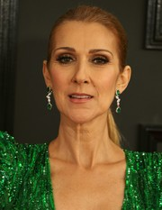 Celine Dion coordinated her dress with a pair of green gemstone earrings by Dvani for the 2017 Grammys.