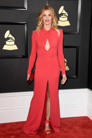 Faith Hill complemented her chic dress with red ankle-tie sandals by Stella Luna.