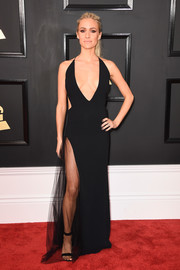 Kristin Cavallari went majorly seductive at the 2017 Grammys in a black Olima halter gown with a plunging neckline and a hip-high slit.