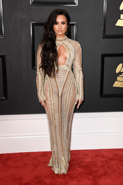 Demi Lovato's nude Julien Macdonald dress at the Grammys was all sorts of sexy with its sheer fabric, curve-hugging silhouette, and cleavage-baring cutout!