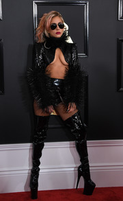 The flamboyant singer coordinated her jacket with a pair of thigh-high PVC platform boots. So very Lady Gaga!