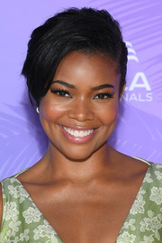 Gabrielle Union looked edgy-glam with her side-parted updo at the 2019 Monte Carlo TV Festival.