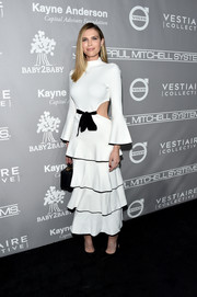 Sara Foster chose a white Proenza Schouler dress with waist cutouts, bell sleeves, and a tiered skirt for her Baby2Baby Gala look.