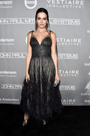 Camilla Belle looked wondrous in this beaded and feathered confection by Monique Lhuillier at the Baby2Baby Gala.