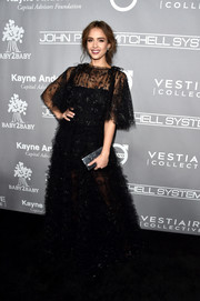 Jessica Alba matched her lovely dress with a black box clutch by Edie Parker.