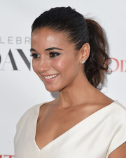 Emmanuelle Chriqui played up her eyes with a smoky application of blue shadow.