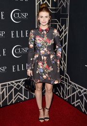 Holland Roden teamed her dress with a pair of black evening sandals with metal ankle straps.