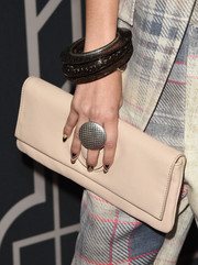 Zendaya Coleman attended the 2014 Elle Women in Music event carrying a beige leather clutch by Oroton.