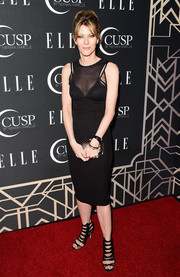 Robbie Myers completed her all-black ensemble with a studded hard-case clutch.
