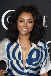 Kat Graham topped off her look with edgy, teased waves when she attended the Elle Women in Music celebration.
