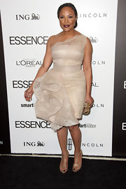 Lynn Whitfield wore this nude lace cocktail dress with a structural pouf to the Essence Luncheon.