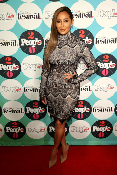 Adrienne Bailon sheathed her curvy figure in a form-fitting lace dress for the People En Espanol Festival.