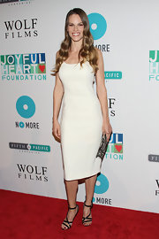 Hilary Swank arrived at the Joyful Revolution Gala wearing a lovely ivory slip dress paired with sexy strappy sandals.