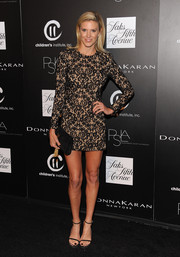 Kelly Noonan went for a leggy look with this super-short lace dress at the PSLA Autumn Party.