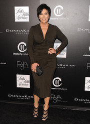 Kris Jenner looked subtly sexy at the PSLA Autumn Party in a ruched brown dress by Donna Karan.
