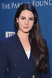 Lana Del Rey styled her hair in a long straight cut at the Help Haiti Home Gala.