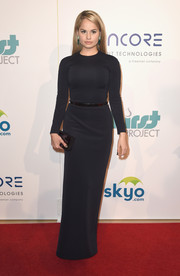 Debby Ryan completed her simple yet elegant look with a black box clutch.