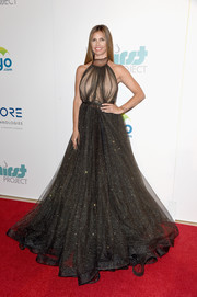 Charisma Carpenter wowed in a sparkly black gown with a sheer-illusion bodice during the Thirst Gala.