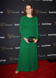 Sigourney Weaver paired a black satin clutch with a long-sleeve green gown for the Voice Arts Awards.