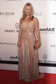 Kate Moss was sultry and sparkly at the amfAR Inspiration Gala Sao Paulo in a nude Givenchy Couture gown with a fitted lace bodice and a sequined skirt.