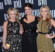 The lovely country singer complemented her floral frock with a metallic Kotur clutch at the 60th Annual BMI Country Awards.