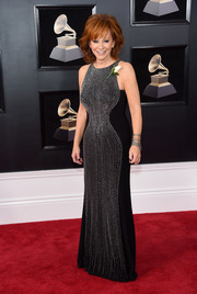 Reba McEntire chose a black Jovani gown with a beaded front for her 2018 Grammys red carpet look.