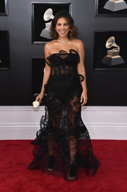 Liz Hernandez went for a daring look with this sheer, strapless black gown at the 2018 Grammys.