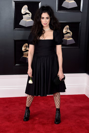 Sarah Silverman looked girly in a puff-sleeved LBD by Maggie Marilyn at the 2018 Grammys.