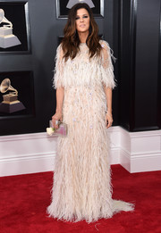 Karen Fairchild got dolled up in a feather-adorned gown by Monique Lhuillier for the 2018 Grammys.