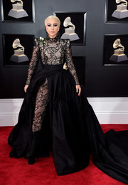 Lady Gaga made a majestic entrance in this black Armani Privé lace bodysuit and ball gown hybrid at the 2018 Grammys.