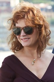 Susan Sarandon looked too glamorous in her oversized rectangular plastic rimmed sunglasses.