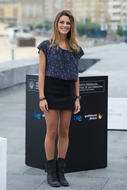 Amaia Salamanca toughened up her floral shirt and mini skirt with these distressed buckled lace-up boots.