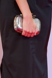 Amaia Salamanca carried another hard case clutch, this time in silver, at the San Sebastian Film Fest.